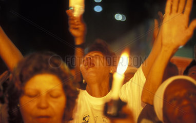 Rio de Janeiro  Brazil. Ecumenical cult for peace. Demonstration against violence. Relatives of violence victims pray together. Citizenship and religious fervour.