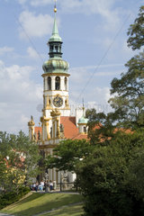 Tower of Loreta Church graphic image of tourist city of Prague in Czech Republic