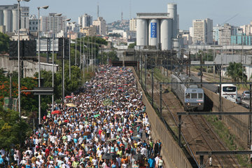 Brazil. Porte Alegre  procession to honour the patreon saint of the sailors.More than 200.000 people are walking with a statue of the patron saint from one church to another along the boulevard of the city.