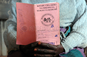Eunice Atieno  a petty trader in Toi Market shows her saving book within the sprawling Kibera slums in Nairobi November 23  2006. Over three thousand petty traders with no formal training in small bussineses trading have come together and are raising more