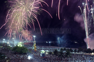 New Year celebration at Copacabana beach  Rio de Janeiro  Brazil. Fireworks. Image illustrates the concepts of joy  party  happiness  positive feelings  crowd  hopeness.