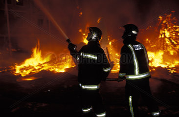 Valencia  firemen controlling the fire at the burning of the ninos the Las Fallas festival