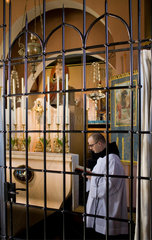 Netherlands; Christianity.Roman Catholicism; Groningen; Warfhuizen. Brother Hugo  the only left Hermit in the Netherlands behind the closure grill. The Hermitage of Our Lady  the Garden Enclosed  is situated in the former parish-church of Warfhuizen  a vi