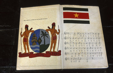 Commwijne district  a book showing the official seal and anthem of Surinam at the museum new Amsterdam