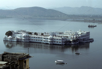 INDIA : Rajasthan. Uidaipur. The Lake Palace  seen from the City Palace. Today the palace is converted into a luxury Hotel.