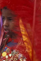 Child celebrating religion. Festa do Rosário ( Rosário Party ). Folklore: Congadas / Marujada. Celebrating holidays and festivals  boy wearing religious dress. City: Serro. State: Minas Gerais  Brazil.