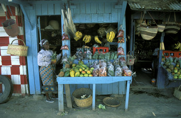 Nairobi  a woman selling fruit and vegetables