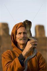 Snake charmer holding an Egyptian Cobra Morocco