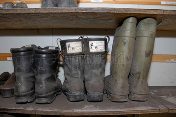 SVALBARD NORWAY Work boots at a coal mine. __Alexander Farnsworth