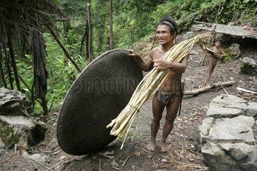 Man and boy in villageTau't Batu Palawan