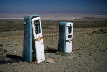 Abandoned service station in Atacama Desert  Chile  South America. Out of order fuel pumps. Solitude  loneliness  wilderness  lonely place  isolation.