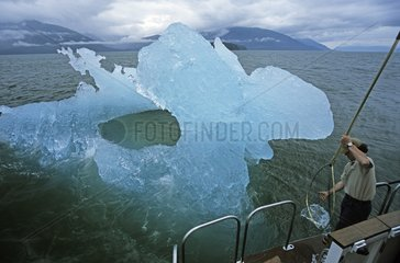 Taking ice for drinking water on an iceberg Frederik Sound