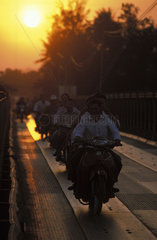 Kampot  evening traffic on the bridge crossing the Prek Kompong river