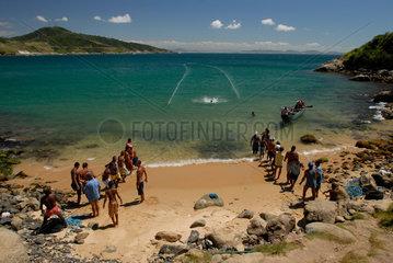 Fishermen gathering fish-net  driving the shoal into a corner  Arraial do Cabo city  Rio de Janeiro State  Brazil.