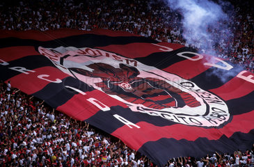 Soccer game - cheering  rooting - Macarana stadium - Rio de Janeiro - Brazil. Flamengo team rooters from Torcida Jovem ( Young Group of Rooters )  organized group of rooters  big Flamengo soccer team flag  Flamengo team supporters  soccer supporters