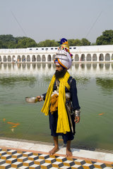 Portrait of colorful Sika Hindu religious man in famous Bangla Shib Gurudwara Sika Great Temple in New Delhi India