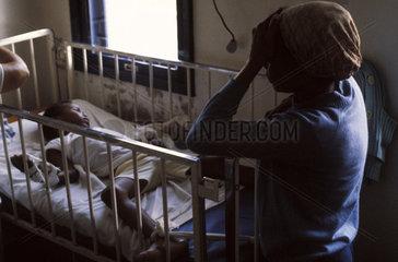 Rio de Janeiro  Brazil. Black woman takes care of her son in a public hospital. Meningitis epidemy.