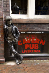 The John Lennon Statue outside the new version of the most famous club in the world The Cavern in Liverpool England where the Beatles started and played 247 times underground
