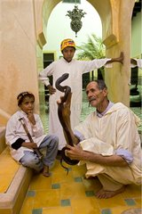 Snake charmer with his sons and a Cobra Marrakech