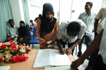 Male  a young couple is signing their wedding contract