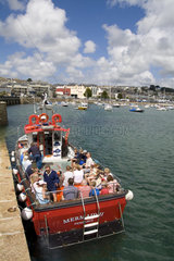 Boats in beautiful harbour in resort town of Penzance Cornwall England southern tip of Britian