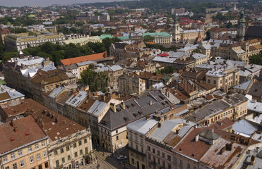 Aerial from above shot from City Hall tower of the beautiful city of Lviv Ukraine looking straight down at the old buildings of city center