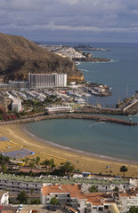 Aerial shot of the beautiful but very developed cove of Puerto Rico in Gran Canaria on the coast of Canary Islands Spain