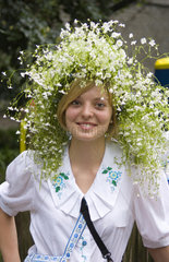 Woman in traditional costume of Ukraine old clothes in festive in Kiev Ukraine with flowers in her hair