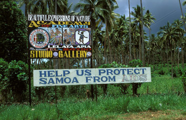 Samoa  warning sign against aids along the road next to an advertisement