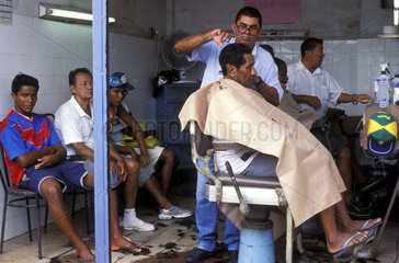 Typical barber-shop from North Brazil  Belem city  Para state. Barber cuts hair while customs wait. dark-skinned men  caboclo  caboclos  acculturated Brazilian Indian  Brazilian half-breed of white and Indian  copper-coloured mulatto with straight black h