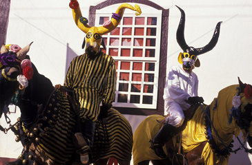 Festa do Divino Espirito Santo ( Divinos Party ) at Pirenopolis; State: Goias  Brazil. Religious party brought to Brazil by the Portuguese jesuits in the beginning of the XIX Century. Horned masks  masquerades riding adorned horse.