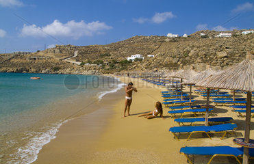Beautiful island of Mykonos Greece with private beach called Super Paradise Beach with tourist taking pictures