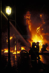 Valencia  firemen controlling the fire at the burning of the ninots during the Las Fallas festival