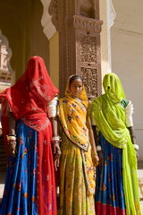Jodhpur at Fort Mehrangarh in Rajasthan India great color graphic image of women in saris in doorway of Fort Palace