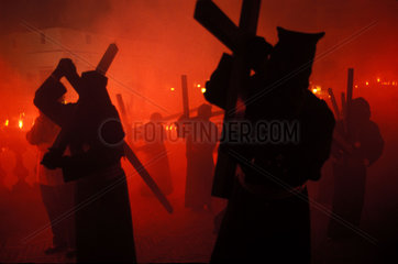 Jerez de la Frontera during the holy week of Eastern fireworks on the stairs of the cathedral accompany a hooded procession with crosses