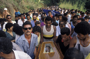 Funeral procession of worker killed during strike demonstrations of Companhia Siderurgica Nacional ( CSN ) in 1988  Volta Redonda city  Rio de Janeiro State  Brazil. burial  enterment  coffin  trade union  labour union  unionized workers  activism  demons
