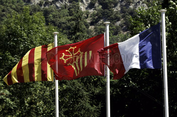 The Cathar flag is raised in between those of France and Catalonia