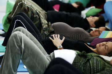 Amsterdam  a group of pregnant women is taking part in a yoga course. Breathing technics are practised
