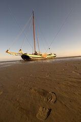 Terschelling  a sailing boat on the Noordsvaarder tidal plate at low tide