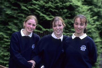Life in Ireland school girls age 15 in traditional uniforms in Adare Ireland