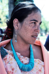 USA. New Mexico. Santa Fe. Pueblo Indian girl. Santa Fe  New Mexico is the oldest capital city in North America and also the oldest European city west of the Mississippi. Each August  the historic city becomes the Santa Fe Indian Market  enveloping the to