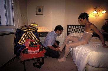 Bullfighter el Gallito is getting dressed in his hotel room