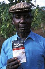 Coffee farmer with Fair Trade coffee