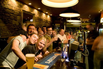 Happy young people at the 21 degree North Bar on Queens Gate Street in the quaint town of Inverness Scotland in the Highlands home of the Loch Ness Monster