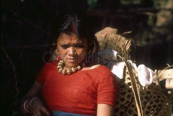 NEPAL : Pokhara. Peasant woman with heavy gold jewelery.