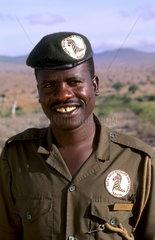 Black African warden for jungle safaris in uniform at Maasai Mara grounds of Kenya Africa at Taita Hills Wildlife Sanctuary