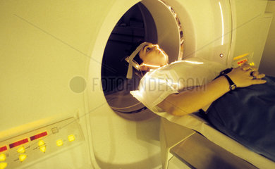 Hospital  patient being submited to medical treatment. Computer science applied to medicine. Computed tomography  the use of x-rays or ultrasound waves to produce an image  for diagnostic purposes  of a chosen section at a particular depth within the body
