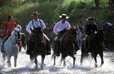 The crossing of the mythical Quema river during the pilgrimage to El Rocio