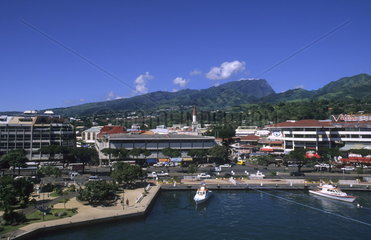 The city and Port of Papeete the largest city in tahiti in French Polynesia in Pacific South Rim
