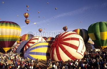 Colorful abstract of hot air balloons in the air in Albuquerque New Mexico at the largest balloon festival in the world called Paint the Sky